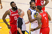 Golden State Warriors guard Stephen Curry (30) holds back Houston Rockets forward Trevor Ariza (1) during an argument with Golden State Warriors forward Draymond Green (23) during Game 3 of the Western Conference Finals at Oracle Arena in Oakland, Calif., on May 20, 2018. (Stan Olszewski/Special to S.F. Examiner)
