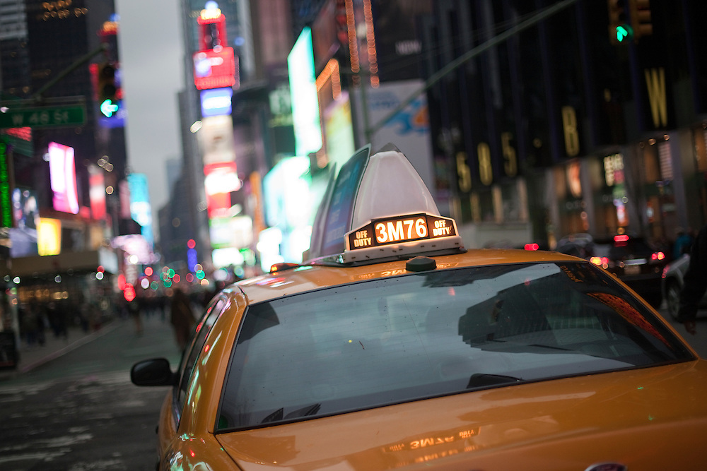Close up of a New York's city taxi sign heading to Times Square in Manhattan area.