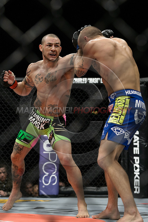 "LONDON, ENGLAND, FEBRUARY 16, 2013: Cub Swanson (L) has his punch blocked by Dustin Poirier during ""UFC on Fuel TV 7: Barao vs. McDonald"" inside Wembley Arena in Wembley, London on Saturday, February 16, 2013 (© Martin McNeil)"
