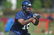 Ole Miss' Aaron Morris (72) works on blocking techniques during football practice in Oxford, Miss. on Sunday, August 7, 2011.