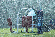 10 Feb 2010 Pennyhill Park, Bagshot, UK: A heavy sudden snow shower obscures scrum training equipment during the England rugby team training camp prior to the match against Italy. (Photo © Andrew Tobin www.slikimages.com)