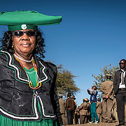 On the weekend nearest 11 June is Mbanderu Day which is when the Green Flag Herero people meet in traditional dress in memory of their fallen chief, Kahimenua Nguvauva executed in Okahandja on June the 13th of 1896 during his fight against the german occupation. In this weekend hundreds of people arrive and set up their tents at a wide space. Women use to wear their traditional big colourful costumes, and men wear military uniforms. The troops march all day to their very own rhythm regardless of the hot sun in the sky and the dust on the ground in memory of their fallen heroes.