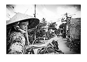 Tearing through a village along the Mekong Delta with a lady of few words and her flower decored horse, Vietnam.