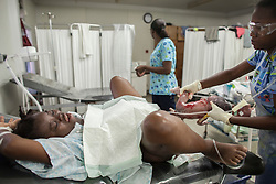 Cherline Pierre, 24, gives birth at MSF's Centre de Référence en Urgence Obstétricale (CRUO) in Port-au-Prince, Haiti, October 16, 2015. She came in the hospital with 8 centimeters dilation and was admitted due to her high blood pressure.