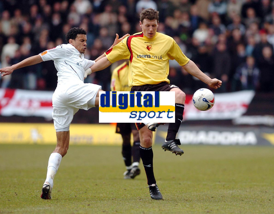 Photo: Leigh Quinnell.<br /> Watford v Luton Town. Coca Cola Championship. 09/04/2006. Lutons Carlos Edwards challenges Watfords Darius Henderson.