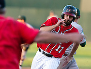 Fargo-Moorhead's Sawyer Carroll rounds third base at the command of RedHawks manager Doug Simunic during play against Gary SouthShore on Wednesday, July 9, 2014, at Newman Outdoor Field in Fargo, N.D.<br /> Nick Wagner / The Forum