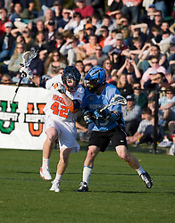 Virginia midfielder Max Pomper (42) is challenged by Johns Hopkins midfielder Michael Kimmel (15).  The #2 ranked Virginia Cavaliers defeated the #6 ranked Johns Hopkins Blue Jays 13-12 in overtime at the University of Virginia's Klockner Stadium in Charlottesville, VA on March 22, 2008.  The loss, in front of a record UVA crowd of 7,500, was the third consecutive overtime defeat for Hopkins, the defending national champions.