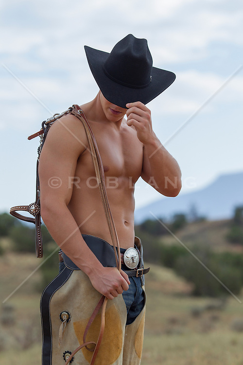 shirtless sexy young cowboy wearing chaps outdoors in New Mexico
