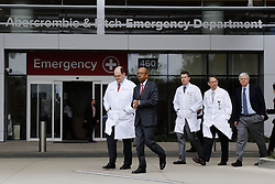 November 28, 2016 - Columbus, OH, USA - Ohio State University president Michael Drake, second from left, and Dr. Andrew Thomas, chief medical officer at the Wexner Medical Center, walk toward a press briefing following an attack on campus on Monday, Nov. 28, 2016 outside The Ohio State University Wexner Medical Center in Columbus, Ohio. Nine people were hospitalized after a man ran into pedestrians with his car then exited his vehicle and began cutting victims with a butcher knife. (Credit Image: © Joshua A. Bickel/TNS via ZUMA Wire)