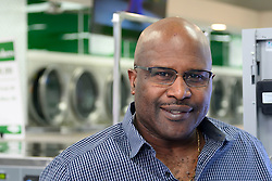 James Betterson, former Philadelphia Eagles Running Back and owner of BetterClean Laundry in NorthEast Philadelphia, on February 15, 2019. Betterson, graduated of the free Power Up Your Business training program will testify next week in city council during a hearing to determine if the program will get extended funding. (Bastiaan Slabbers for WHYY)