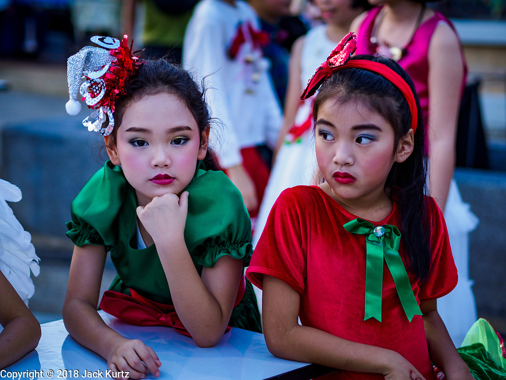 """23 DECEMBER 2018 - CHANTABURI, THAILAND: Girls performing in the pageant waits to go on stage at the Cathedral of the Immaculate Conception's Christmas Fair in Chantaburi. Cathedral of the Immaculate Conception is holding its annual Christmas festival, this year called """"Sweet Christmas @ Chantaburi 2018"""". The Cathedral is the largest Catholic church in Thailand and was founded more than 300 years ago by Vietnamese Catholics who settled in Thailand, then Siam.   PHOTO BY JACK KURTZ"""