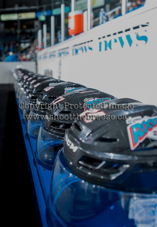 KELOWNA, CANADA - SEPTEMBER 25: The Kelowna Rockets helmets sit on the bench on September 25, 2015 at Prospera Place in Kelowna, British Columbia, Canada.  (Photo by Marissa Baecker/Shoot the Breeze)  *** Local Caption ***