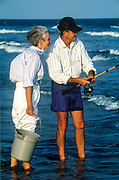 Senior couple spending time together and surf fishing, Outer Banks, North Carolina, NC
