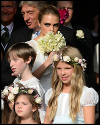 Cara Delevingne watches her sister and her new husband after the service at the wedding of her sister  Poppy Delevingne to James Cook at St.Paul's Church in Knightsbridge, London,  Friday, 16th May 2014. Picture by Andrew Parsons / i-Images