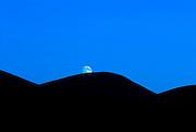 The moon rising over Latrigg Fell, Borrowdale, English Lake District, Cumbria, England, UK