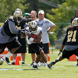 July 29, 2011; Metairie, LA, USA; New Orleans Saints defensive tackle Sedrick Ellis (98) chases running back Pierre Thomas (23) during the first day of training camp at the New Orleans Saints practice facility. Mandatory Credit: Derick E. Hingle