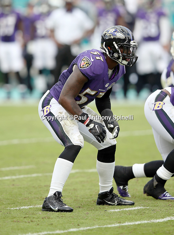 Baltimore Ravens inside linebacker C.J. Mosley (57) gets set for the snap during the 2015 week 13 regular season NFL football game against the Miami Dolphins on Sunday, Dec. 6, 2015 in Miami Gardens, Fla. The Dolphins won the game 15-13. (©Paul Anthony Spinelli)