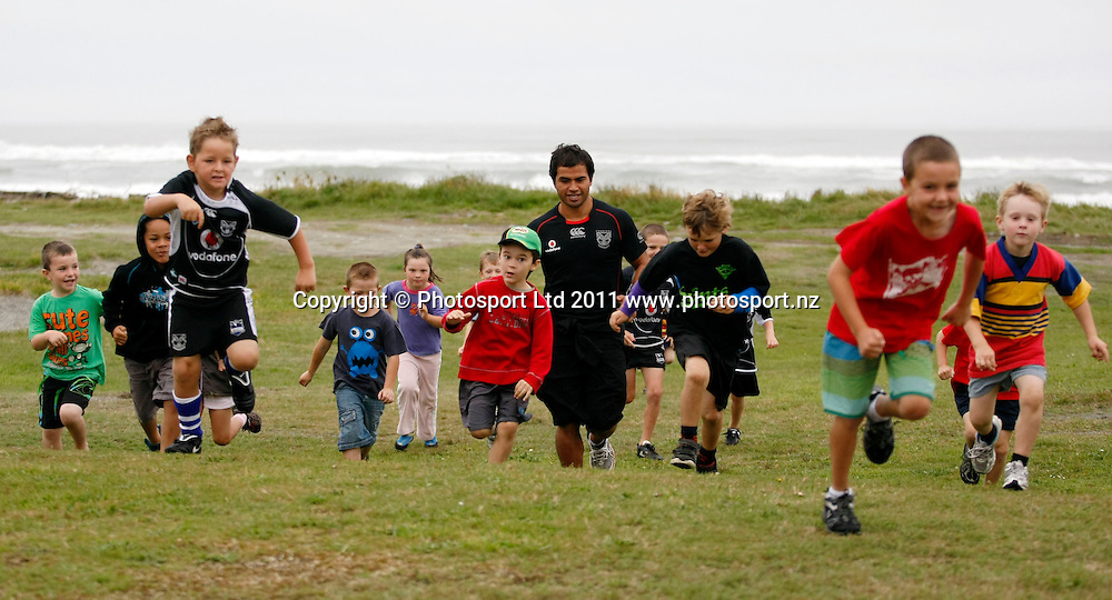 Aaron Heremaia warms up young players. Vodafone Warriors and NZRL Kids' Carnival, Suburbs Rugby League Club , Greymouth. Saturday 5 February 2011 . Photo: Simon Watts / photosport.co.nz