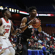 Chris Silva, (right), South Carolina, drives past Yankuba Sima, St. John's, during the St. John's vs South Carolina Men's College Basketball game in the Hall of Fame Shootout Tournament at Mohegan Sun Arena, Uncasville, Connecticut, USA. 22nd December 2015. Photo Tim Clayton