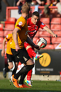 Dean Cox of Leyton Orient (right) shoots during the Sky Bet League 1 match at the Matchroom Stadium, London<br /> Picture by David Horn/Focus Images Ltd +44 7545 970036<br /> 29/03/2014