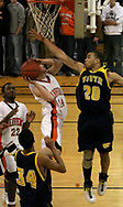 The Wildcats Vince Martin (20) jumps to block the Beavers Kyle Eakins' (14) shot as the Beavercreek Beavers host the Springfield South High School Wildcats Friday night, February 2, 2007.