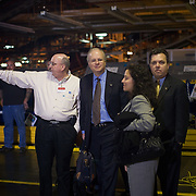 Deputy Chief of Staff Karl Rove looks on as President Bush tours the Ford Motor Company -- Kansas City Assembly Plant Tuesday, March 20, 2007, in Kansas City, MO.  Tour guides are Mayor Jim Stoufer; Alan Mulally, President and CEO of Ford Motor Company; Ken Ward, Plant Manager. <br /> <br /> Photo by Khue Bui