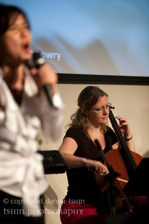 (L-R) Vocalist Catherine Harsono (foreground) and cellist Hannah Wood of the worship team leading the Evangelical Church of Bangkok (ECB) during the Easter service on 24 April 2011 in Bangkok, Thailand