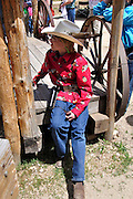 Young contestant in a fast draw competition during Pioneer Days festival in Idaho City, Idaho