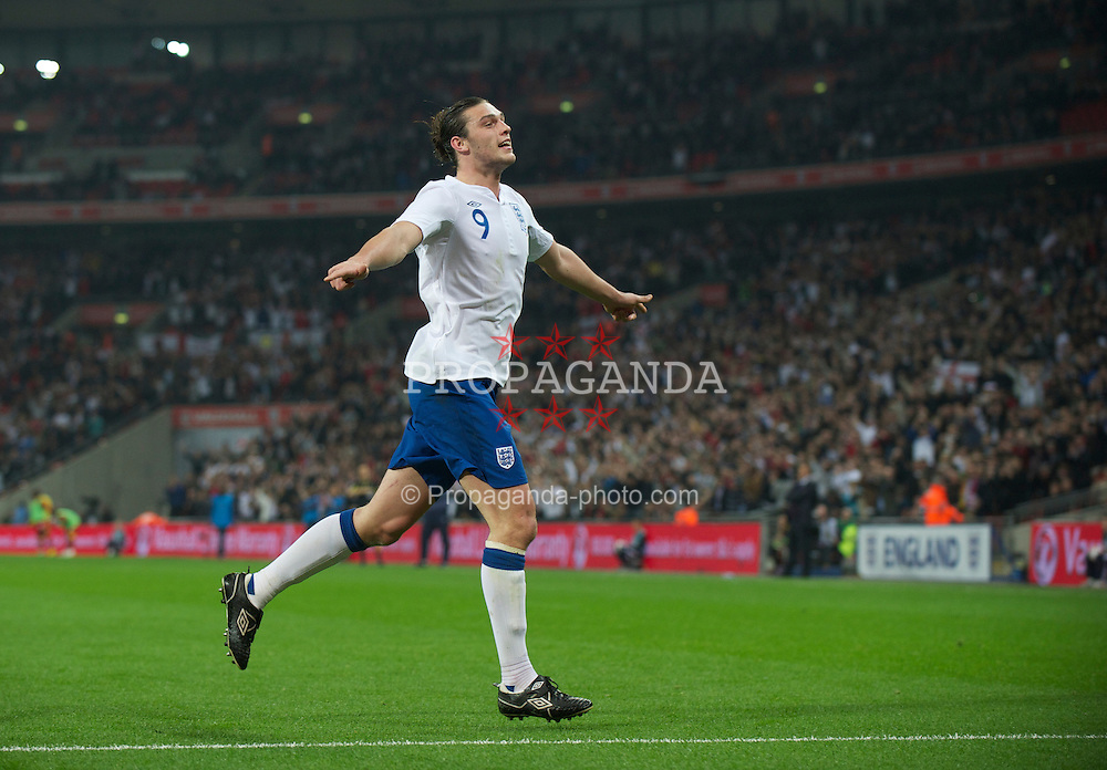 LONDON, ENGLAND - Tuesday, March 29, 2011: England's Andy Carroll celebrates scoring the first goal against Ghana during the international friendly match at Wembley Stadium. (Photo by David Rawcliffe/Propaganda)