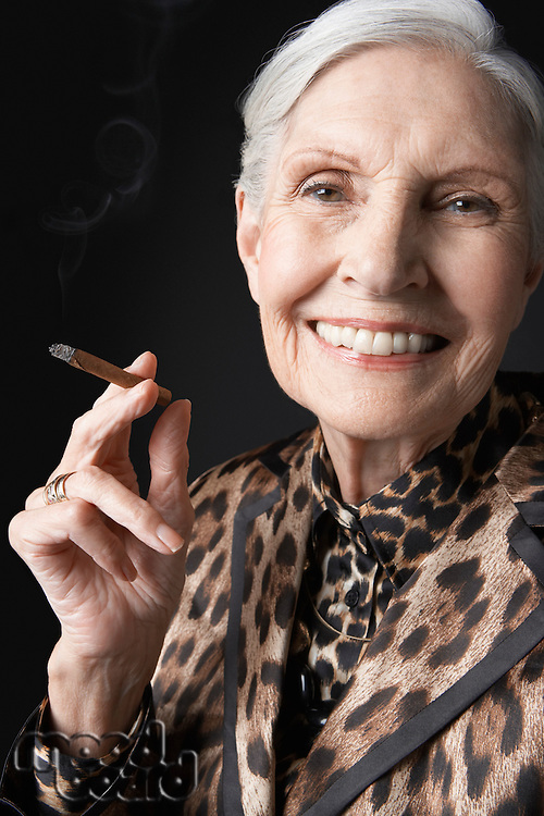 Senior Woman Smoking Cigarillo