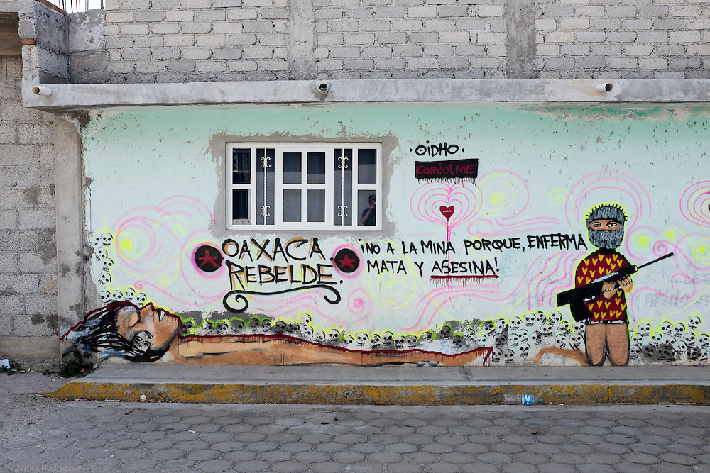 "Anti-mining mural painted on the main street of Tlamanca by participants of the 2014 Mexican Network of Mining-Affected Peoples (REMA, for its initials in Spanish) Encounter. The mural reads: ""No to the Mine because it sickens, kills and murders!"" Hundreds of people from mining-affected communities throughout Mexico gathered for three days to exchange experiences, renew alliances and discuss strategies. Tlamanca, Zautla, Puebla, México. March 16, 2014."