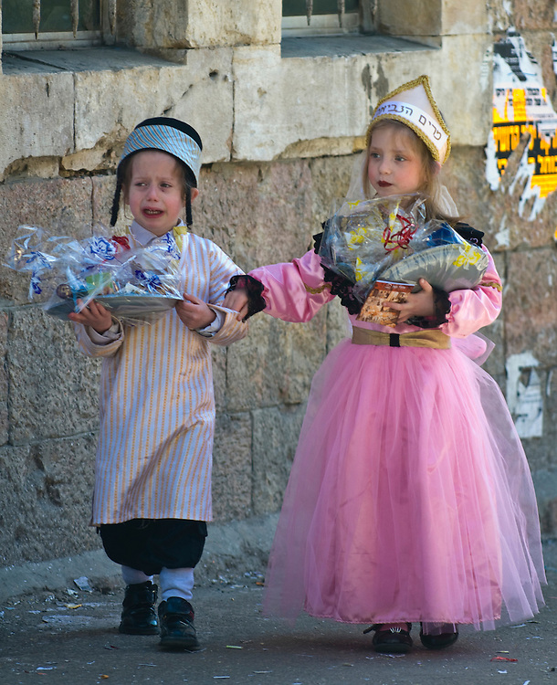 JERUSALEM - MARS 09 : Ultra Orthodox children holding Mishloach Manot during Purim in Mea Shearim Jerusalem on Mars 09 2012 , Mishloach Manot is traditional food gifts given during Purim