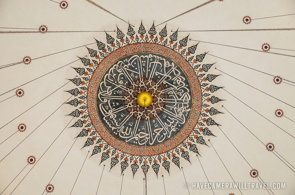 The ornate design at the apex of the ceiling dome in Istanbul's Rustem Pasha Mosque near the Spice (Egyption) Market. The vertical lines are wires suspending the lighting from the ceiling.