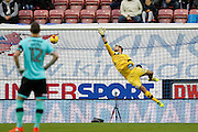 Wigan's Jussi Jaaskelainen (22) sees the header from Derby's Bradley Johnson (15) sail past him into the net for the first goal 0-1 during the EFL Sky Bet Championship match between Wigan Athletic and Derby County at the DW Stadium, Wigan, England on 3 December 2016. Photo by Craig Galloway.