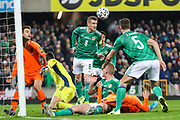 Northern Ireland midfielder Steven Davis (8) heads the ball away from danger during the UEFA European 2020 Qualifier match between Northern Ireland and Netherlands at National Football Stadium, Windsor Park, Northern Ireland on 16 November 2019.