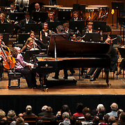 "March 11, 2013 - New York, NY : .The London Philharmonic Orchestra lead by conductor Vladimir Jurowski (mostly obscured by piano), with piano soloist Hélène Grimaud, performs Ludwig van Beethoven's Piano Concerto No. 4 in G major (1804-07), as part of Lincoln Center's ""Great Performers"" series at Avery Fisher Hall on Monday evening..CREDIT: Karsten Moran for The New York Times"