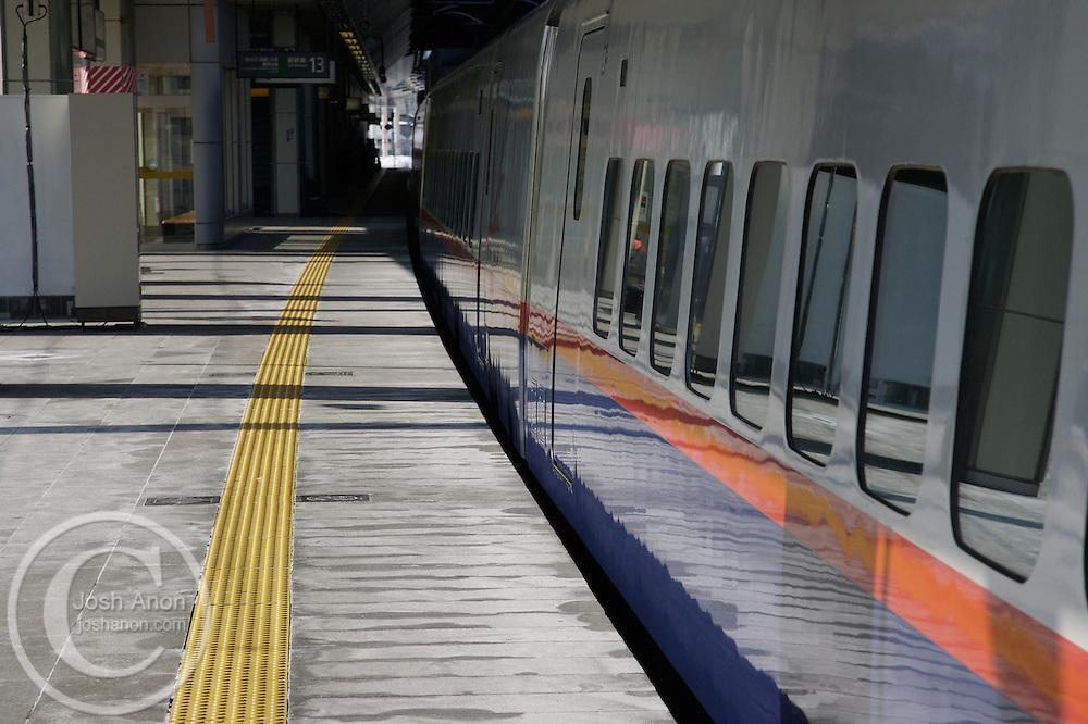 An empty train waits on a platform near Nagano, Japan.