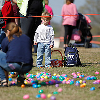 Thomas Wells | BUY at PHOTOS.DJOURNAL.COM<br /> Jackson McClain, 3, of Saltillo watches closely as volunteers begin spreading out the eggs for Saturday hunt at Ballard Hunt.