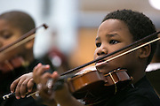 """Dennis Welch performs with his """"Concertino Strings"""" group at the ROC The Night Away holiday concert at the David F. Gantt Community Center in Rochester on Wednesday, December 17, 2014."""