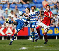 Photo: Steve Bond/Richard Lane Photography. Reading v Nottingham Forest. Coca Cola Championship. 08/08/2009. Scott Davies (L) hooks the ball clear in front of Radoslaw Majewski (R)