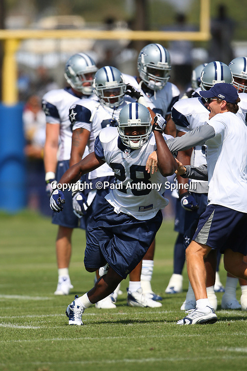 OXNARD, CA - JULY 26:  Rookie running back Felix Jones #28 of the Dallas Cowboys works his way around a coach while going out for a pass during the 2008 Dallas Cowboys Training Camp at River Ridge Field in Oxnard, California on July 26, 2008. ©Paul Anthony Spinelli *** Local Caption *** Felix Jones