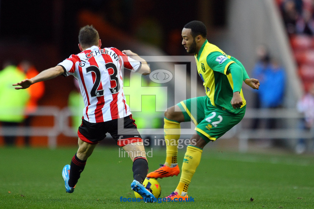 Picture by Paul Chesterton/Focus Images Ltd +44 7904 640267<br /> 21/12/2013<br /> Nathan Redmond of Norwich and Sunderland's Emanuele Giaccherini in action during the Barclays Premier League match at the Stadium Of Light, Sunderland.
