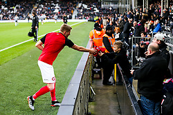 Taylor Moore of Bristol City gives his warm up top to a fan - Rogan/JMP - 07/12/2019 - Craven Cottage - London, England - Fulham v Bristol City - Sky Bet Championship.