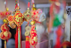 Washington, Seattle, International District, Asian dragon ornaments hanging in shop