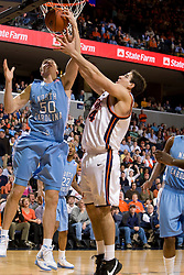 North Carolina forward Tyler Hansbrough (50) grabs a rebound from Virginia forward/center Ryan Pettinella (34).  The Virginia Cavaliers men's basketball team faced the #3 ranked North Carolina Tar Heels  at the John Paul Jones Arena in Charlottesville, VA on February 12, 2008.