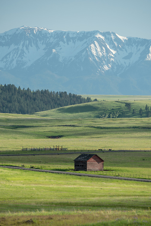 Old barn on Oregon's Zumwalt Prairie with the Wallowa Mountains in the background.