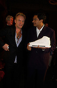Aniruddha Bahal and Sting, Literary Review Bad Sex in Fiction Award. In and Out Club, St. James, Sq. 3 December 2003. © Copyright Photograph by Dafydd Jones 66 Stockwell Park Rd. London SW9 0DA Tel 020 7733 0108 www.dafjones.com