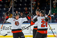 KELOWNA, BC - NOVEMBER 8: Jonathan Brinkman #19, Eric Van Impe #28 and Trevor Longo #20 of the Medicine Hat Tigers celebate a goal against the Kelowna Rockets at Prospera Place on November 8, 2019 in Kelowna, Canada. (Photo by Marissa Baecker/Shoot the Breeze)