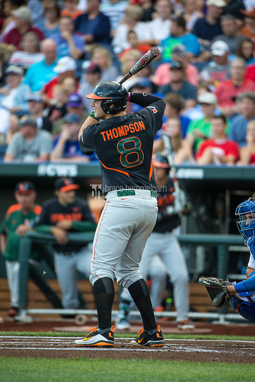 David Thompson (8) of the Miami Hurricanes bats during a game between the Miami Hurricanes and Florida Gators at TD Ameritrade Park on June 13, 2015 in Omaha, Nebraska. (Brace Hemmelgarn)