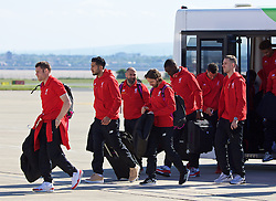 LIVERPOOL, ENGLAND - Monday, May 16, 2016: Liverpool's James Milner, Emre Can, Joe Allen, Christian Benteke and captain Jordan Henderson board their plane to Basel as they fly out of Liverpool John Lennon Airport to Switzerland ahead of the UEFA Europa League Final against Sevilla FC. (Pic by David Rawcliffe/Propaganda)
